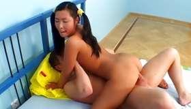 Asian sluttish lady is riding on tremendous hot dog